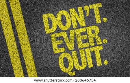 Dont. Ever. Quit. written on the road - stock photo