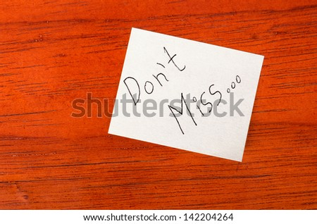 Dont Miss  - Post it Note on Wood Background - stock photo