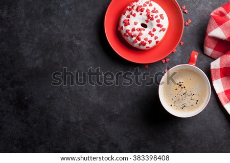 Donut and coffee on stone table. Top view with copy space - stock photo