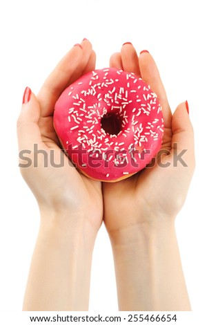 Donut in woman's hands on white background