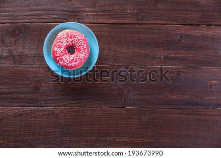 Donut on woodent table. - stock photo