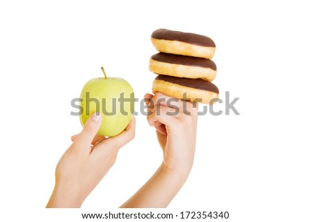 Donut or green apple - hard choice. Diet concept.