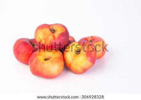 donut peaches. flat peaches on the background - stock photo