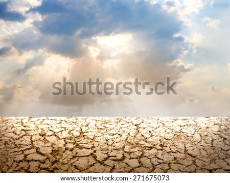 Donut ring cloud with sun with front cracked land soil
