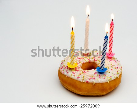 donut with candle - stock photo