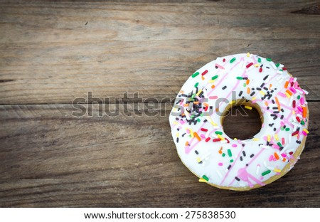 Donut with sprinkles - stock photo