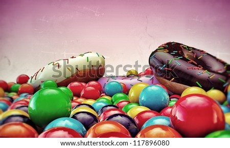 donuts and gumballs isolated on pink background - stock photo