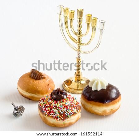 Donuts, dreidel and Hanukkah  candles for Jewish holiday of Hanukkah. - stock photo