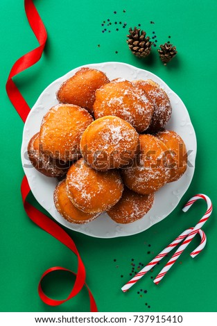donuts filled with jam, marmalade or cream on a plate . festive New Year or Christmas style