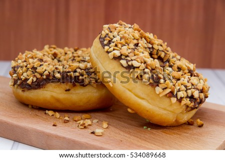Makanan stock images royalty free images vectors shutterstock donuts in indonesian kue donat coklat kacang chocolate nut donut on wooden background altavistaventures Image collections