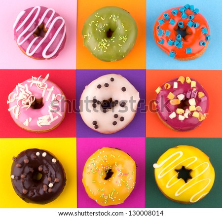 Donuts isolated on colorful background - stock photo