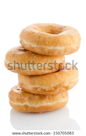 Donuts on a white reflective background.