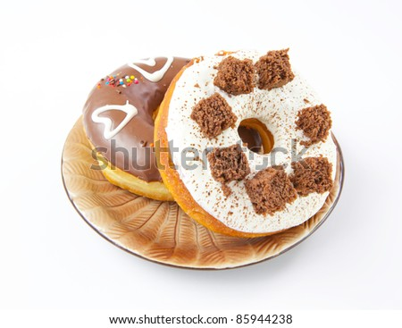 donuts on the plate isolated on a white background - stock photo