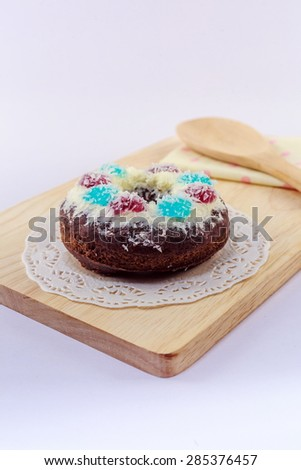Donuts on wood white background.