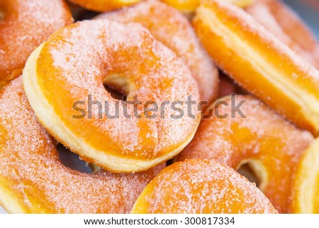donuts strewed with icing sugar close up - stock photo