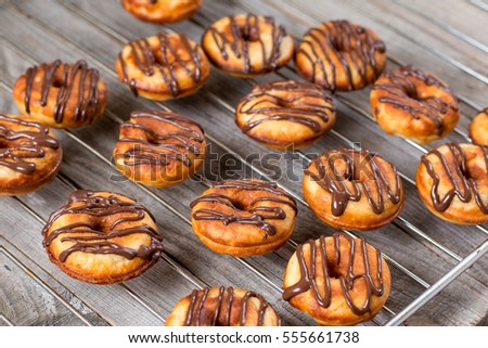 donuts with chocolate on wooden background