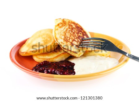 donuts with cream and jam on a white background - stock photo