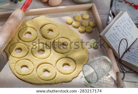 Donuts with fresh ingredients in the sunny kitchen - stock photo