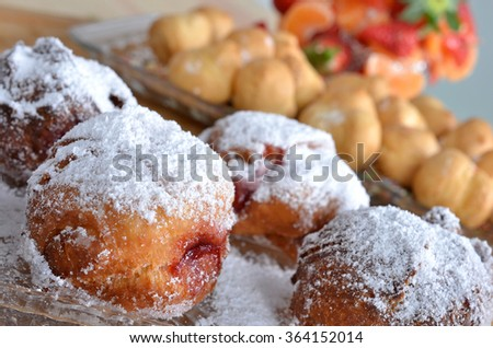 Donuts with sugar and jam filling