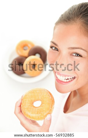 Donuts. Woman eating donut smiling on white background