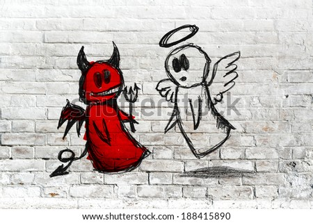 Doodle drawing of angel and devil fighting on white brick wall. Concept of conscience; decisions, uncertainty, moral dilemma; fight of good and evil. - stock photo