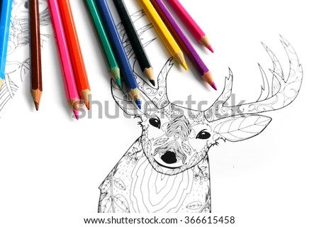 Doodle drawing of deer and colour pencils - stock photo