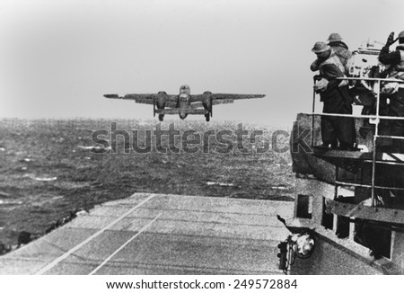 Doolittle Raid, April 18, 1942. An Army B-25 bomber takes off from the USS HORNET in first U.S. air raid on Japan lead by General James Doolittle during World War 2. - stock photo