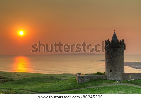 Doonegore castle at sunset in Doolin, Ireland - stock photo