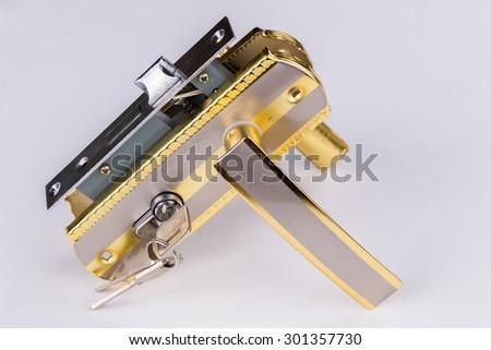 Door accessories. door lock, door handle and keys. - stock photo