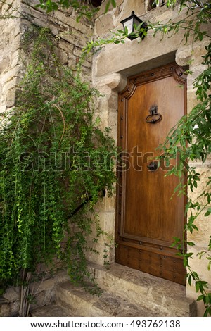 Door and facade of an old French house in a village
