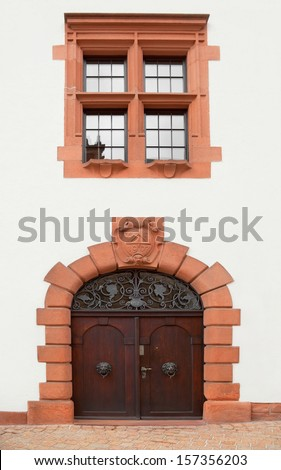 Door and window at the facade of 1907 building in Speyer, Germany