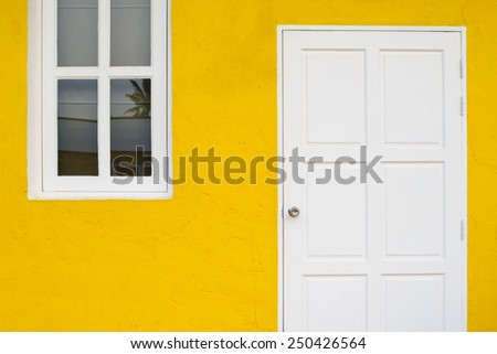 Door and windows in white and yellow - stock photo