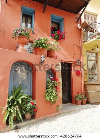 door architecture detail in house building with bougainvillaea Greece - stock photo