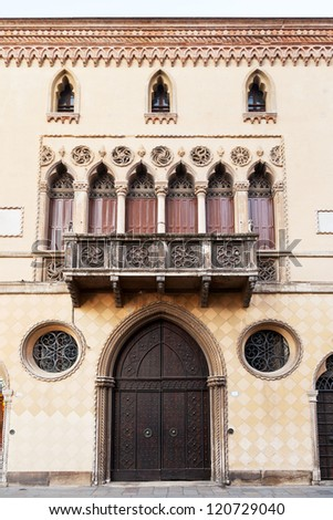 door, balcony of medieval house in Bologna, Italy - stock photo