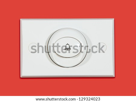 Door bell on red background