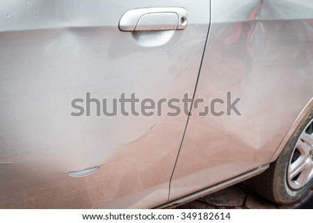 Door car with damage on accident with dent on left side on raining day - stock photo