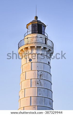 Door County, Wisconsin's Cana Island Lighthouse glows warm in the light of the rising sun on Lake Michigan. - stock photo