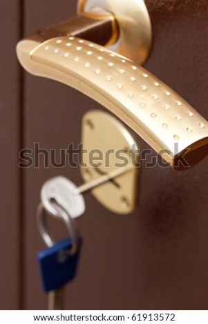 Door handle and secure lock in new apartment - stock photo
