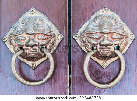 Door handle chinese style on wooden. - stock photo