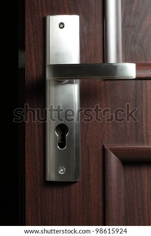 Door handle dark background, nobody, keyhole