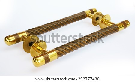 Door handle in gold on a white background