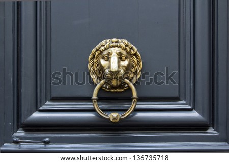Door handle Lion with ring in mouth - stock photo