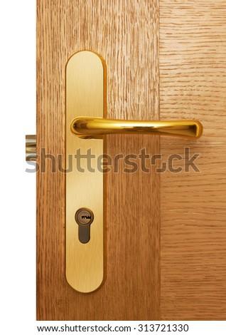 Door handle on natural wooden door - stock photo