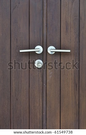 door handle on the brown door - stock photo
