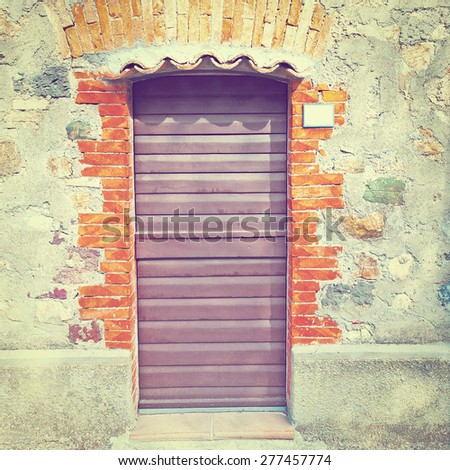 Door in a Brick Wall of the Old  Italian House, Instagram Effect - stock photo
