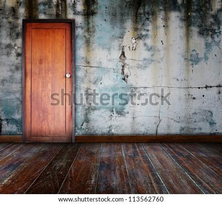 Door in grunge room. - stock photo