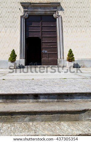 door   in italy  lombardy   column  the milano old   church   closed brick  pavement