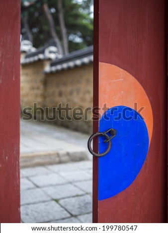 Door in Sungsinjeon shrine in Gyeongju, South Korea. Visible half of yin yang symbol.