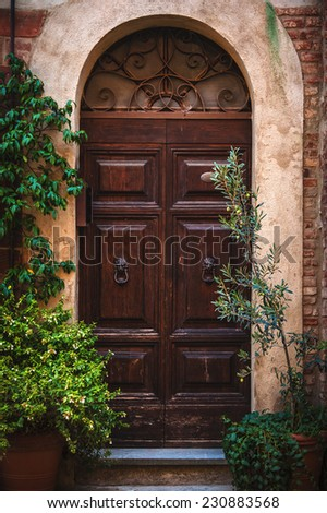 Door in the alley of the old Tuscan town, Italy - stock photo