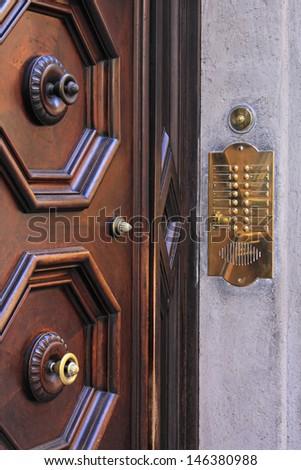 Door intercom and bell buttons in brass - stock photo